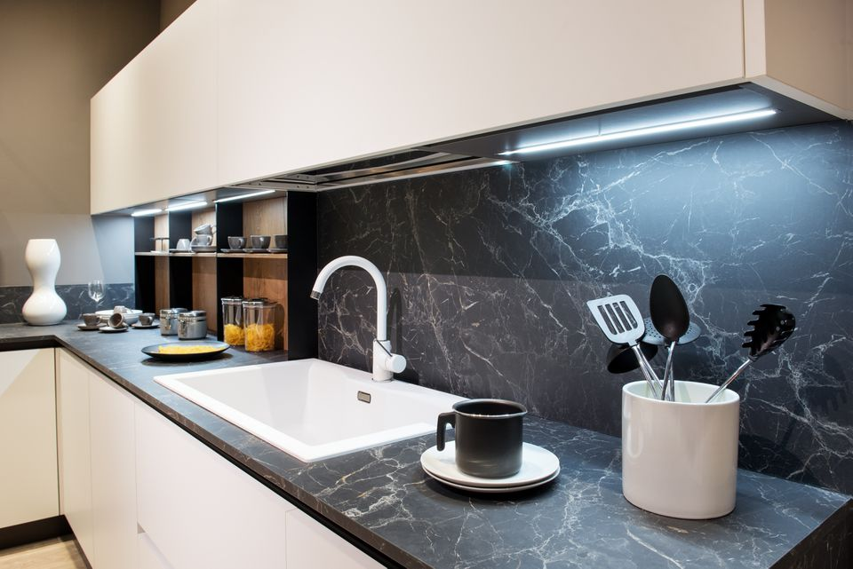 Marble effect kitchen counter with utensils
