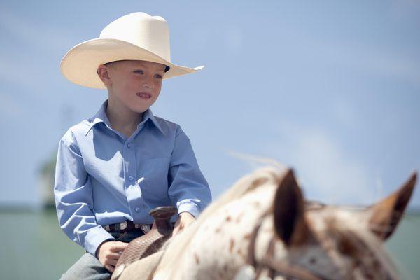 Young Caucasian boy riding a horse