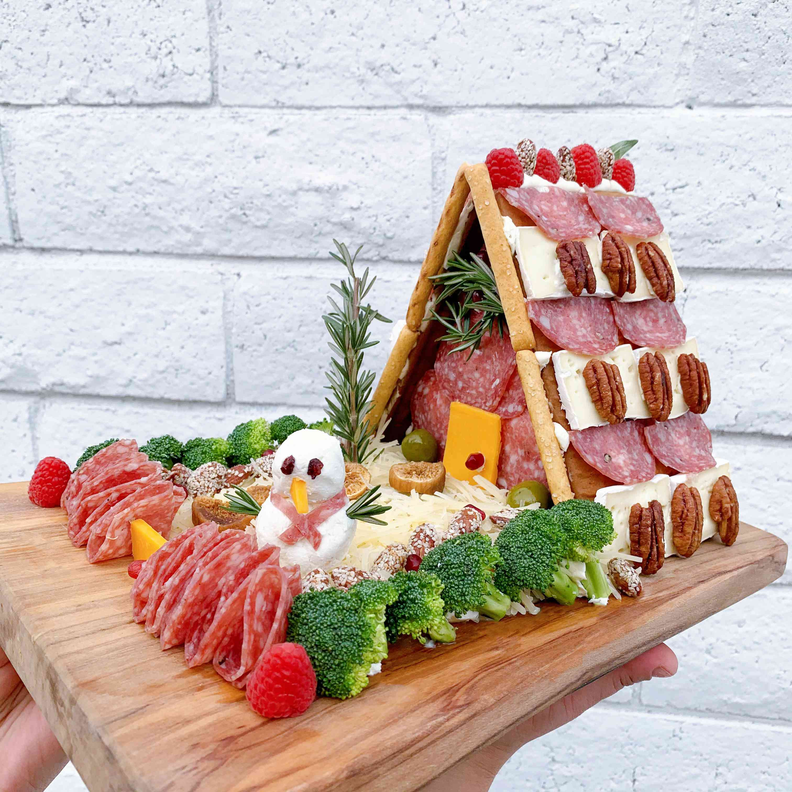 A-frame charcuterie chalet with broccoli lane and snowman