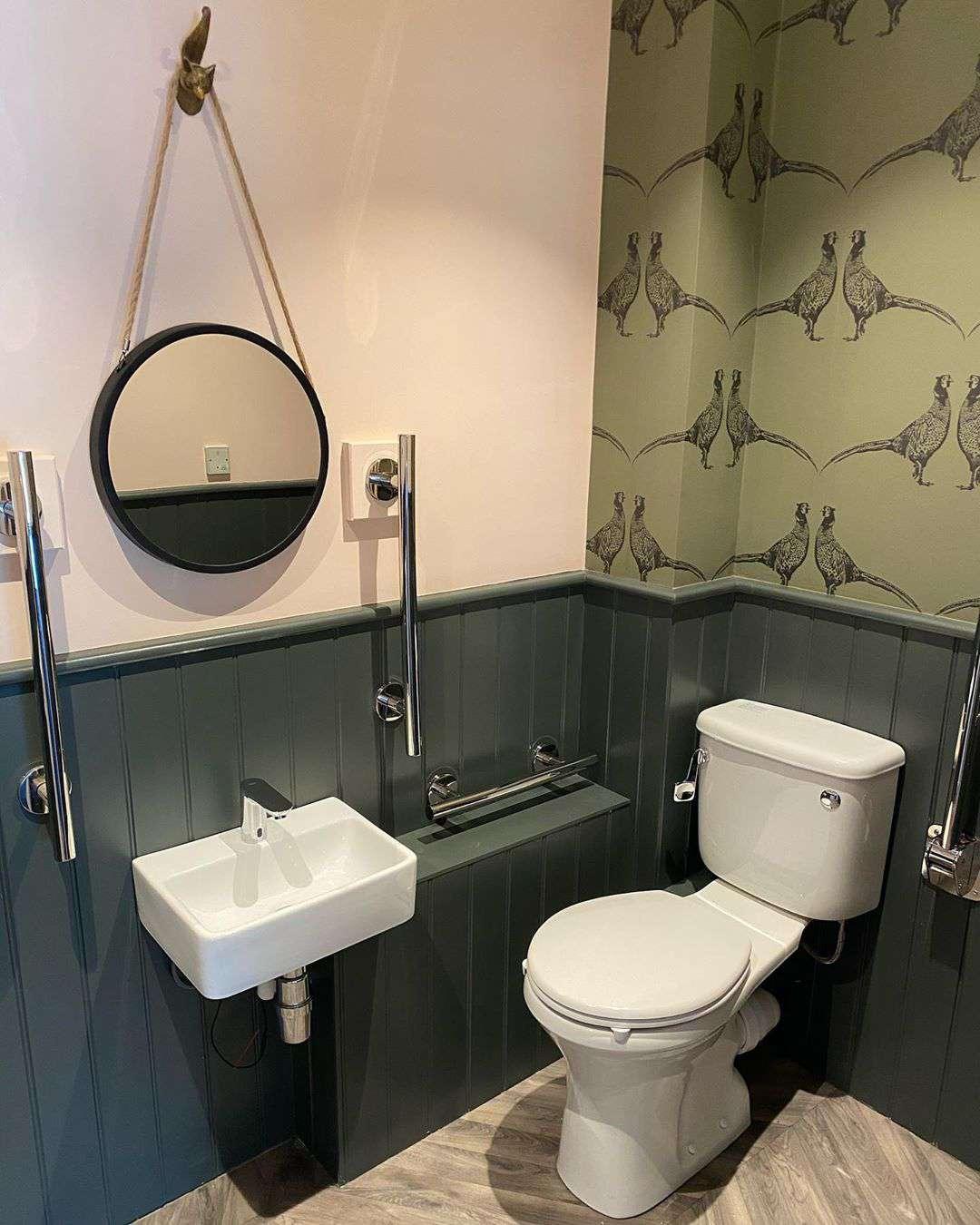 Bathroom with green siding