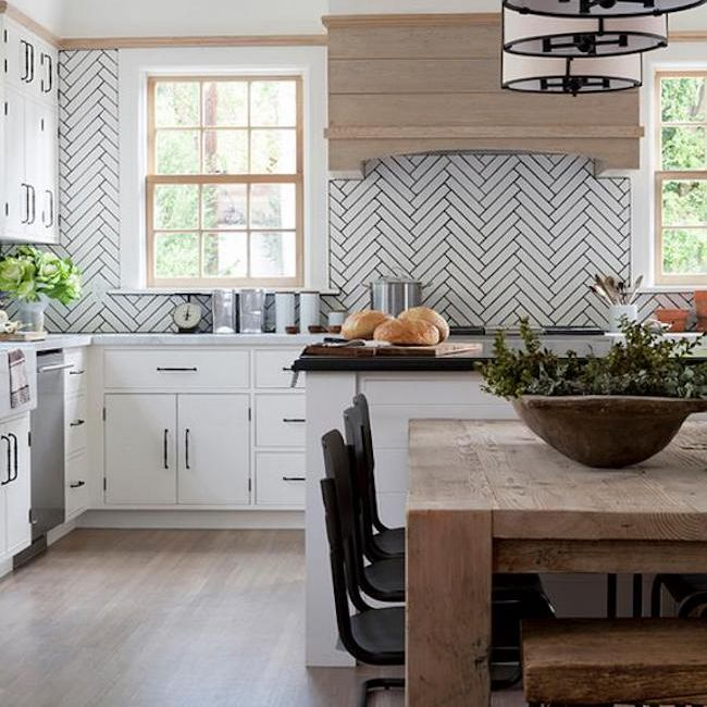 kitchen with wood table and chevron tiles