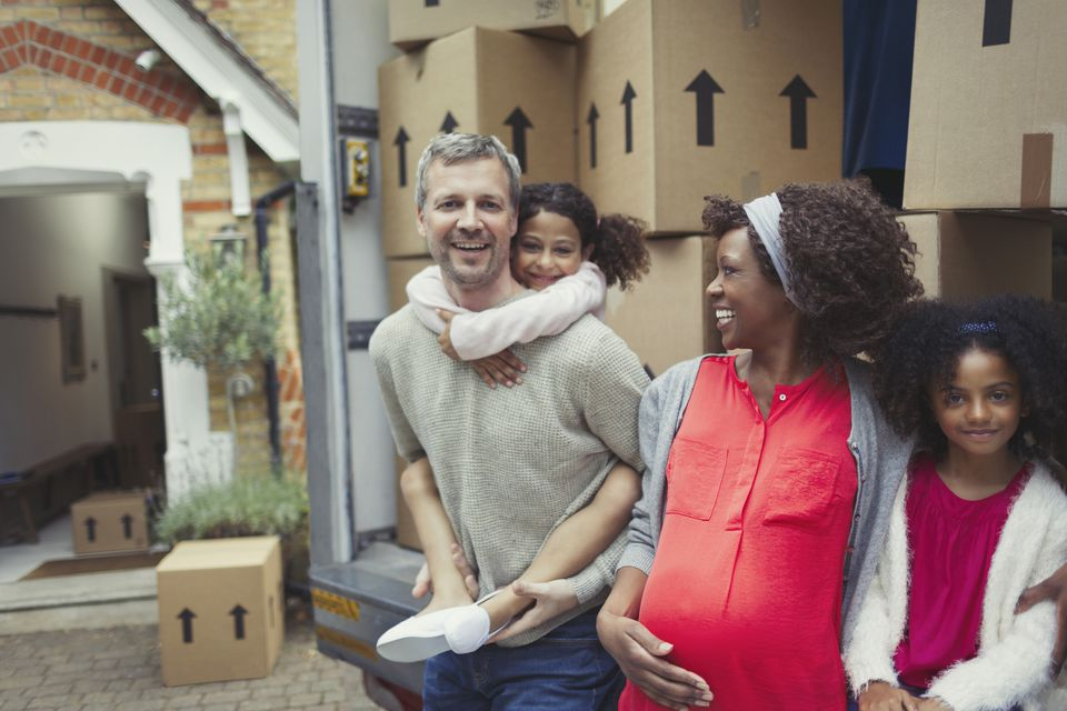 Multi-ethnic young family moving into new house