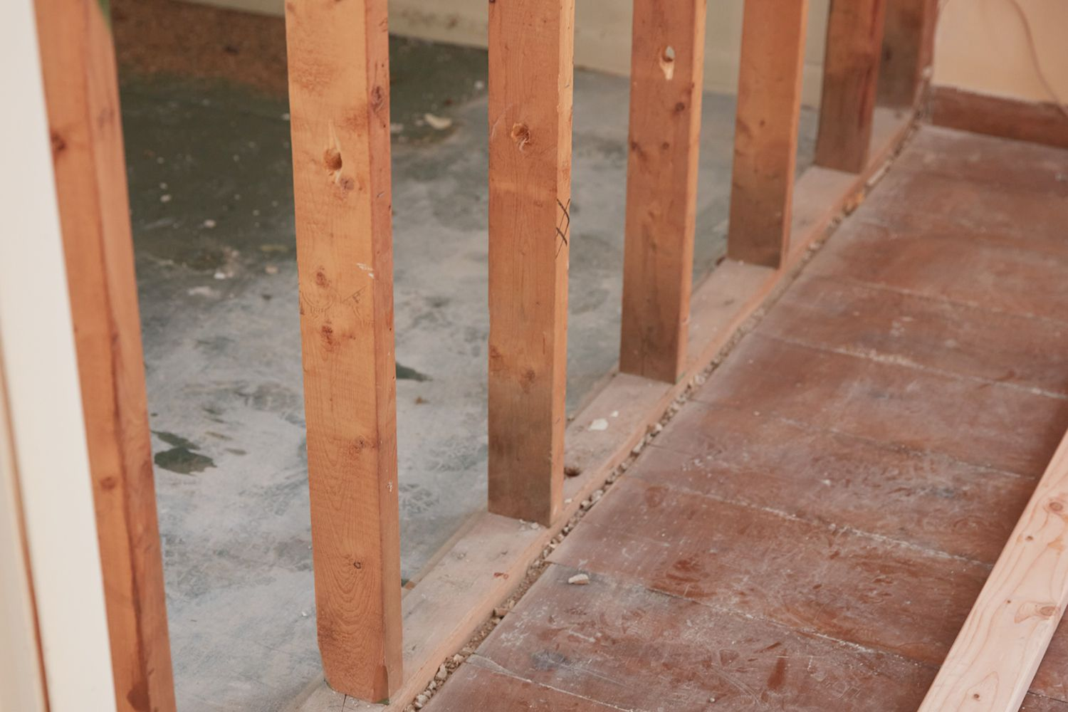 Studs at bottom of wooden support beams