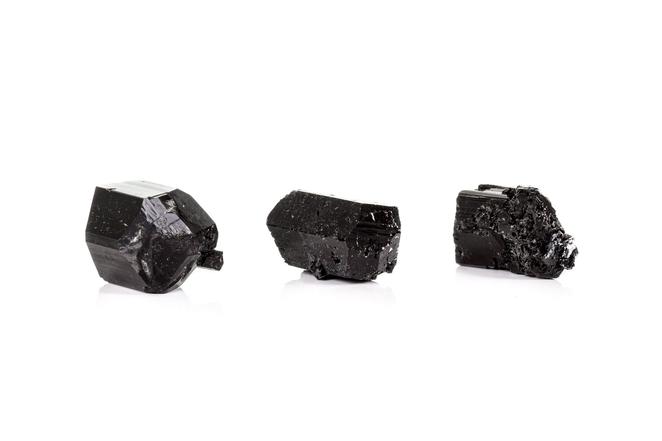 three pieces of black tourmaline crystals for space clearing