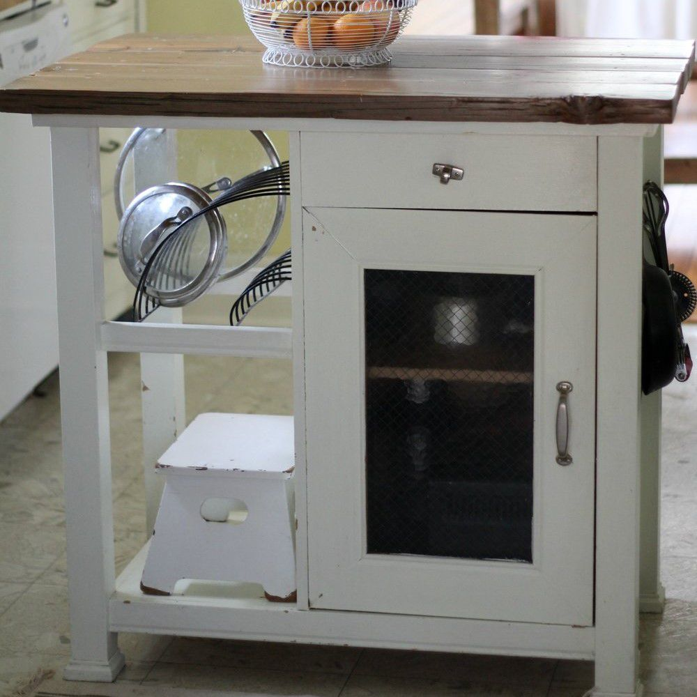 A kitchen island made from a rustic cabinet