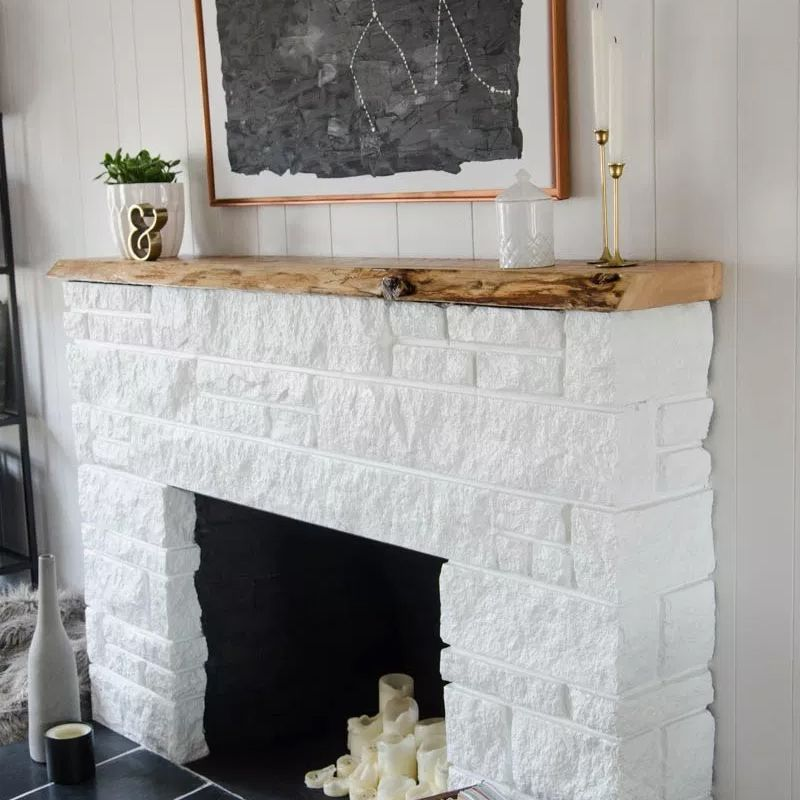 A white brick fireplace