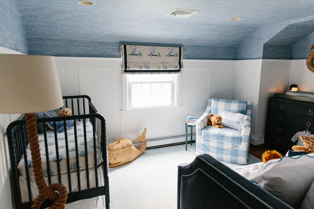Nautical nursery with ocean-inspired, wallpapered ceiling.