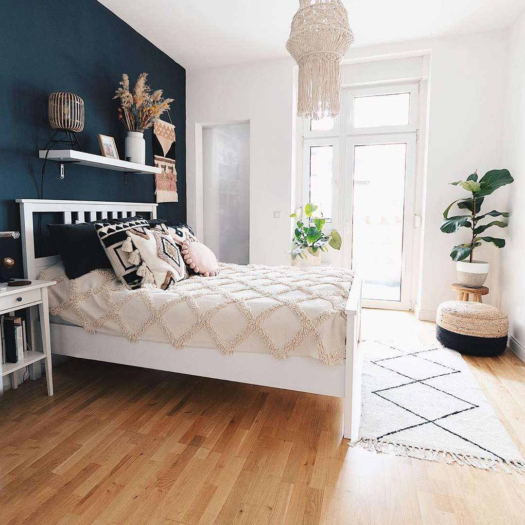 Bedroom with a dark blue wall