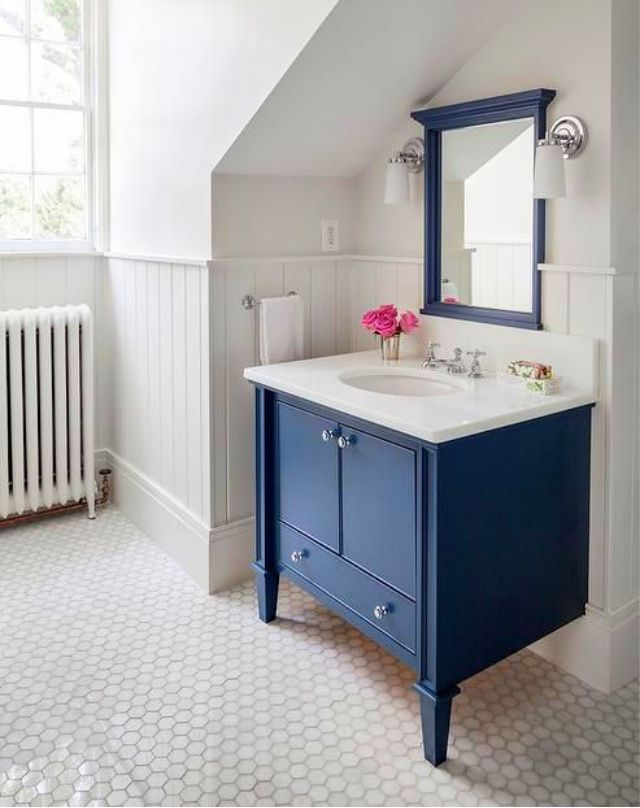 Blue vanity in white bathroom