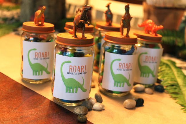 A set of dinosaur themed jar party favors
