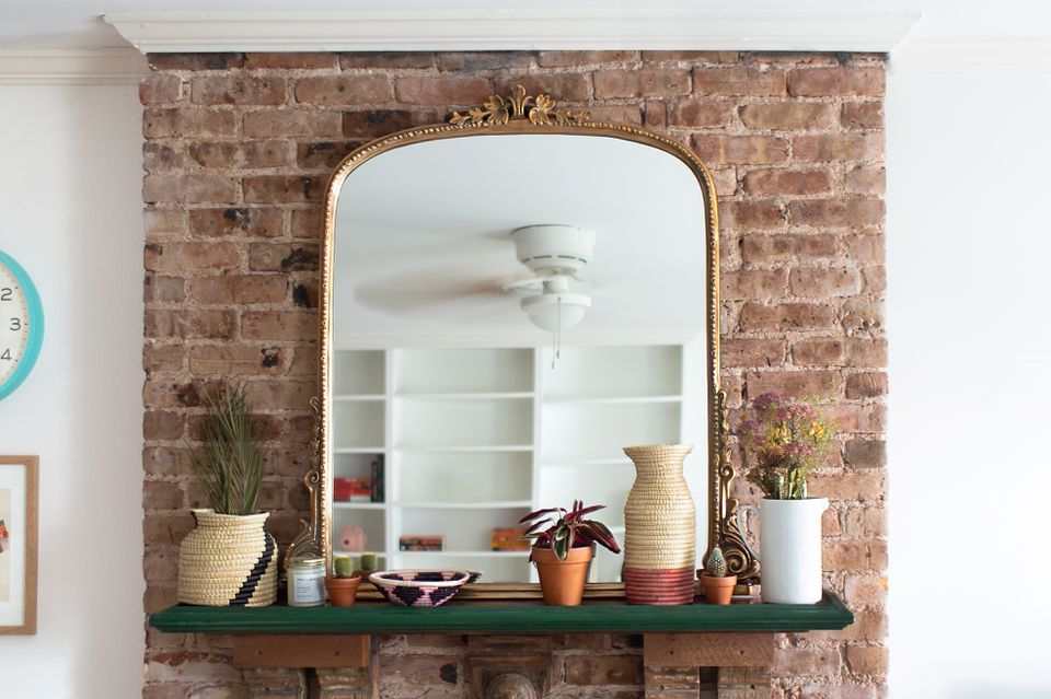 mirror and accessories over fireplace mantel