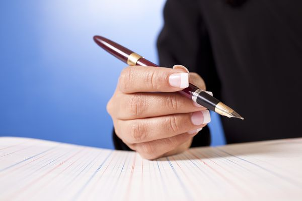 Woman writing with a fountain pen