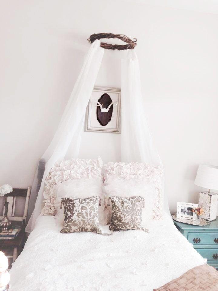 Girl's room with beautiful DIY wreath canopy.