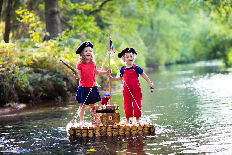 settings Kids playing pirate adventure on wooden raft