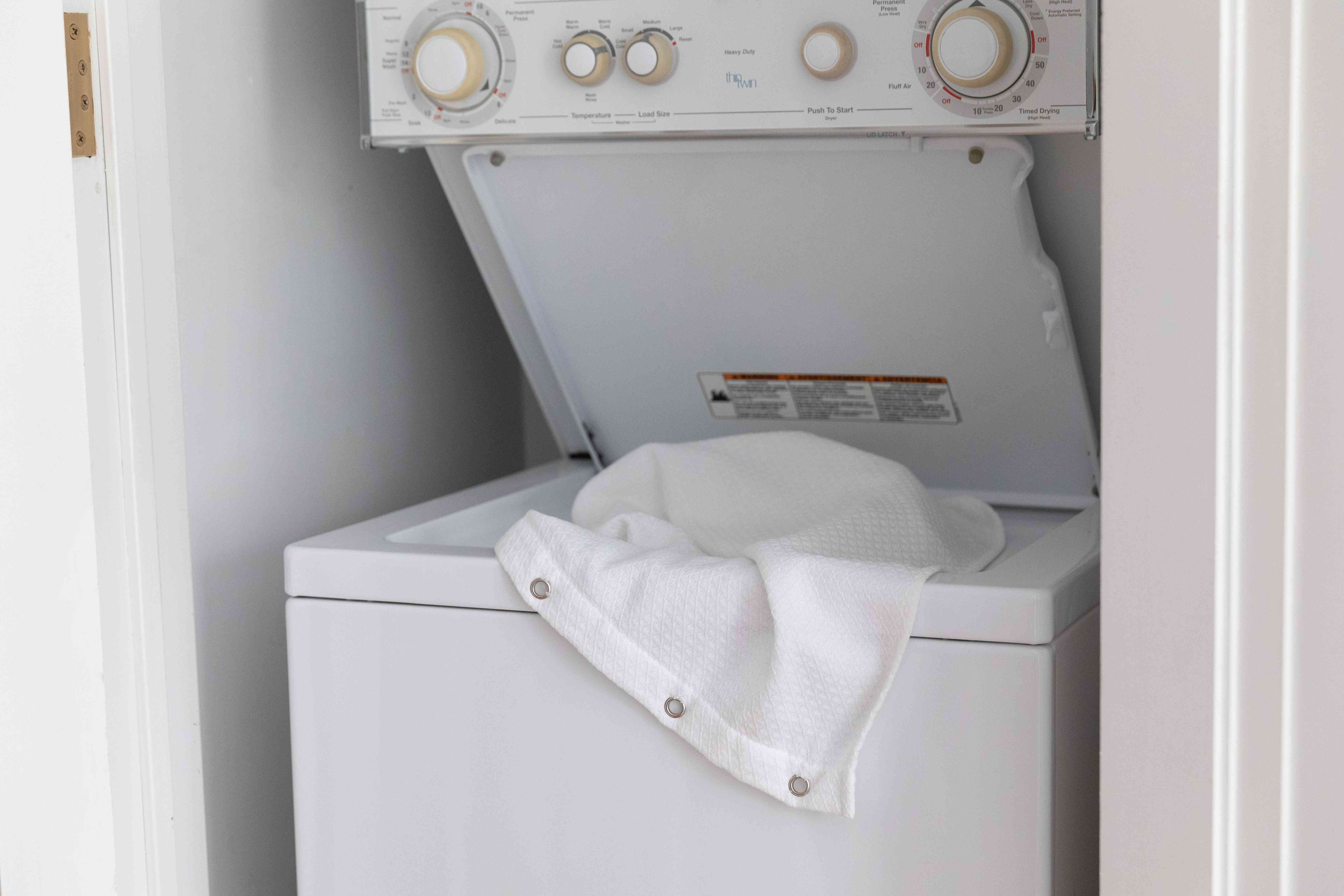 Shower curtain and liner placed in washing machine to prevent pink growth