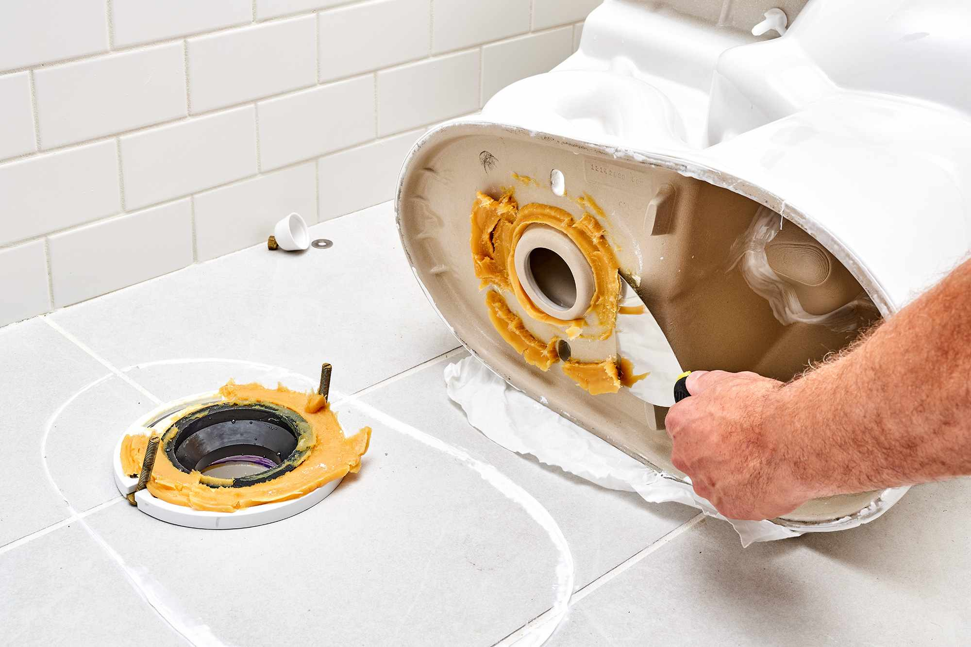 Bottom of toilet cleaned with putty knife to scrape off old wax for cleaning