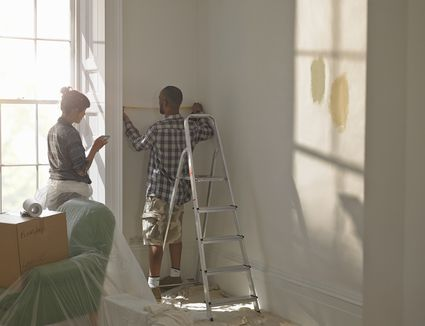 Couple measuring new home