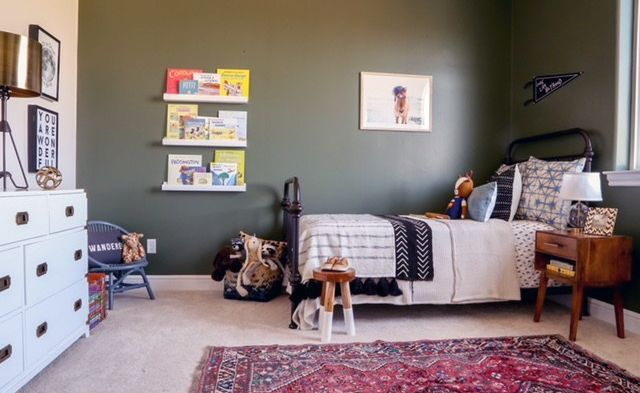 Boys room with dark green paint -