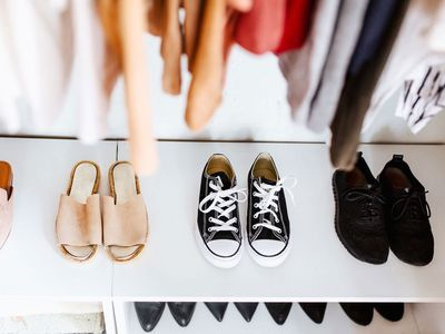 shoes on a bottom shelf in the closet