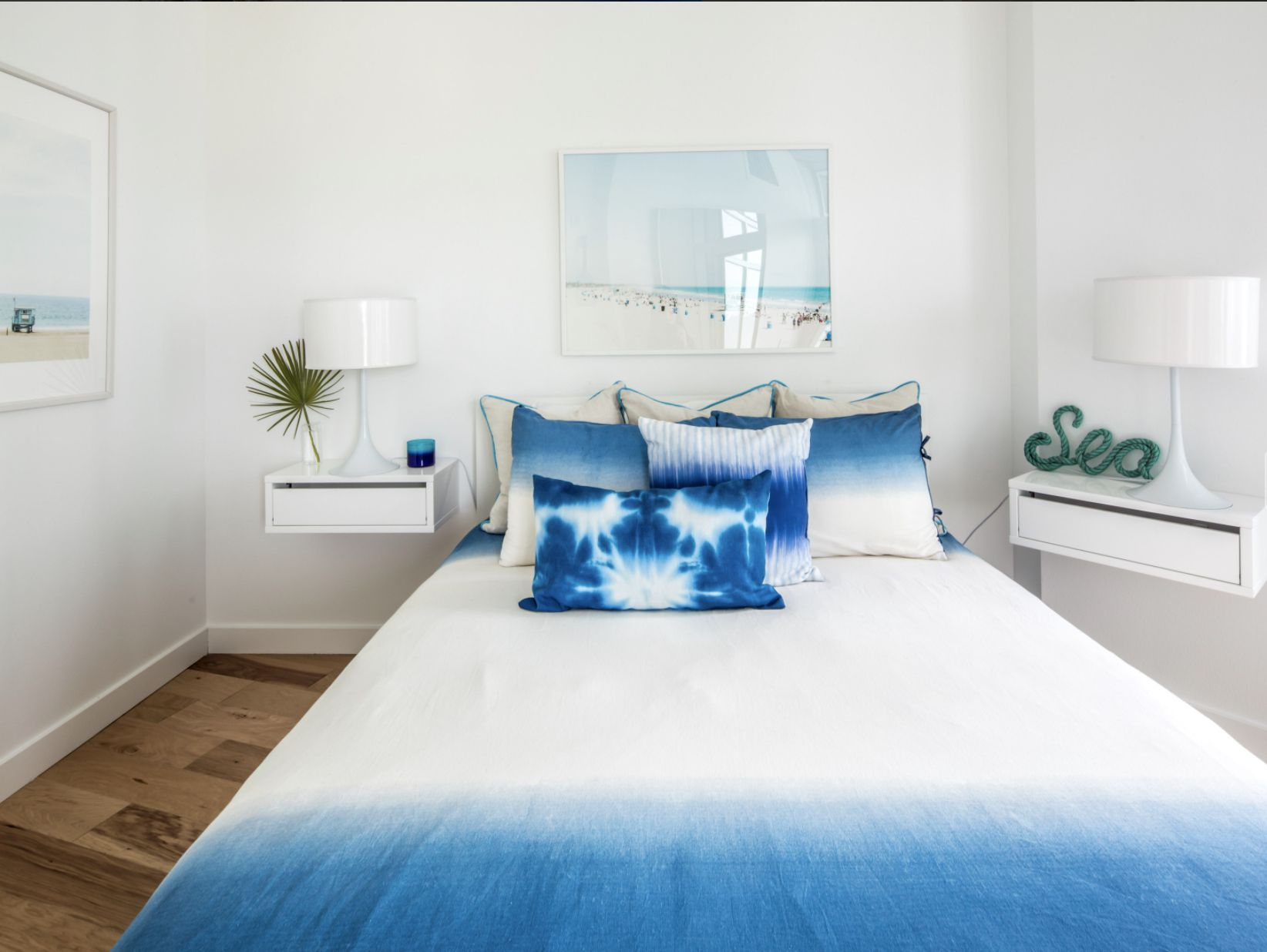 bedroom with floating side tables