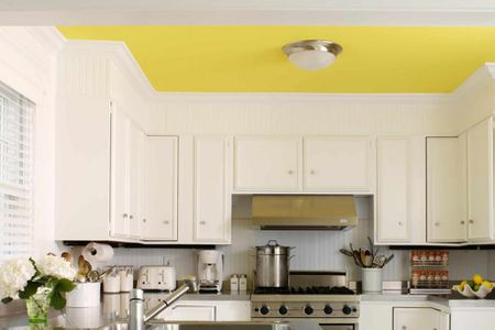 A White Room With Lemon Yellow Ceiling