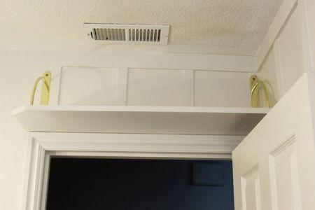 Shelf above the door in a bathroom