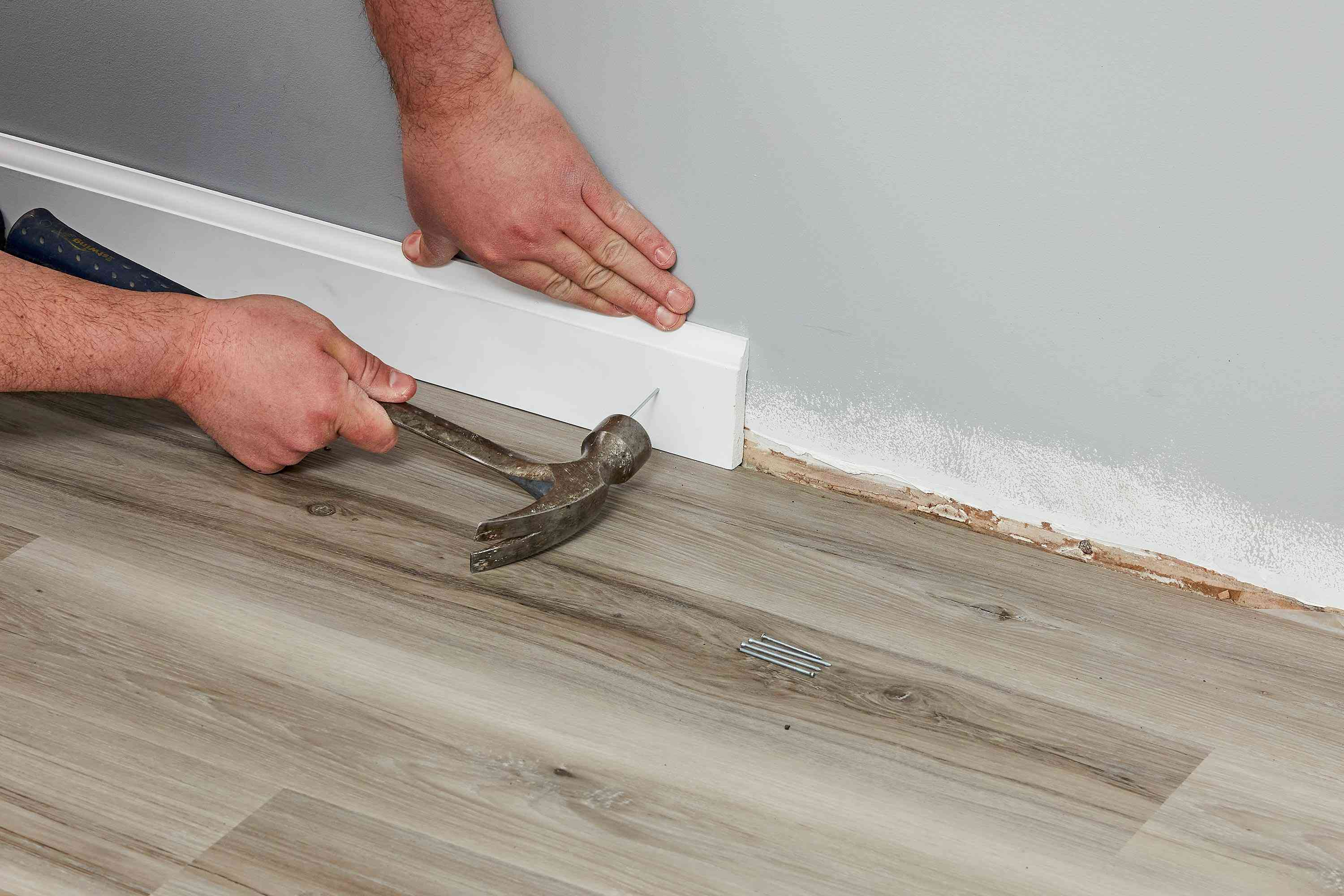 White trim reinstalled by hammer and nail