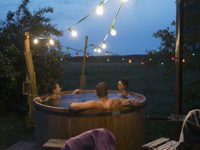 Three adults in hot tub