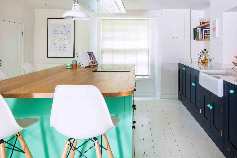 green, navy and white kitchen