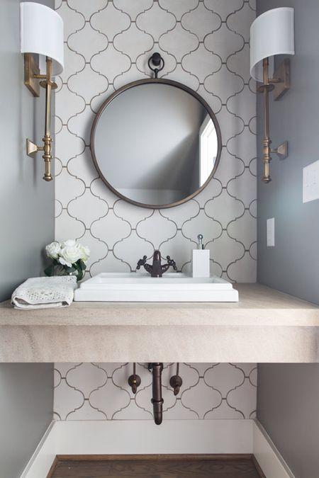 Feminine Powder Room With Floating Limestone Washstand