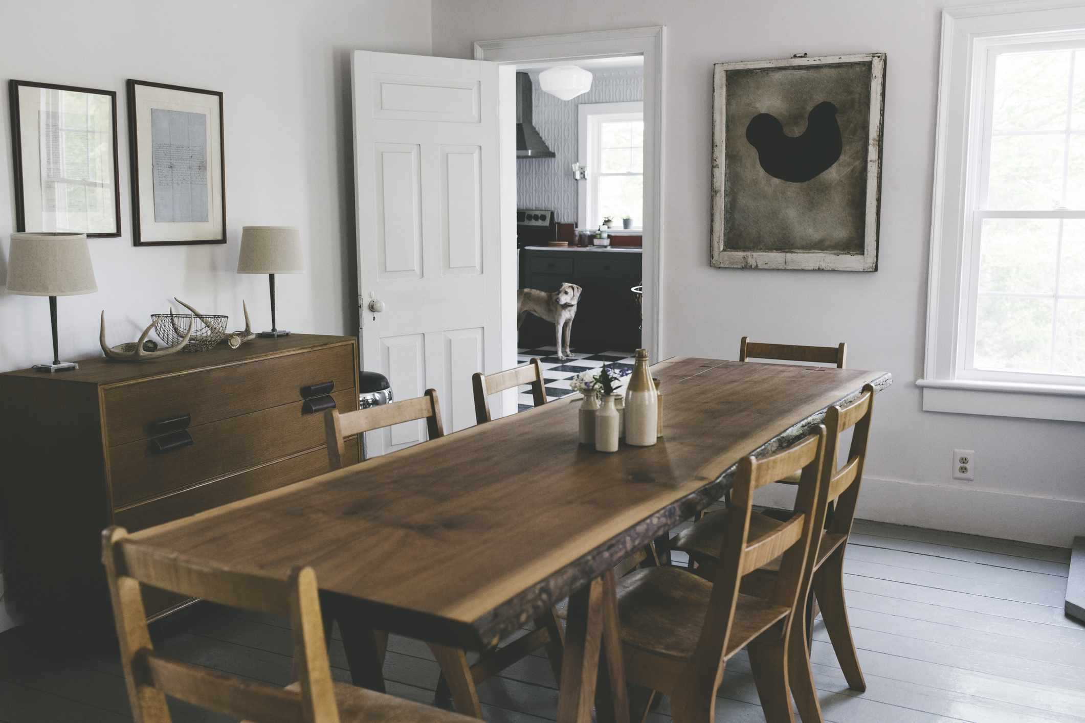 A rustic dining room with handmade table