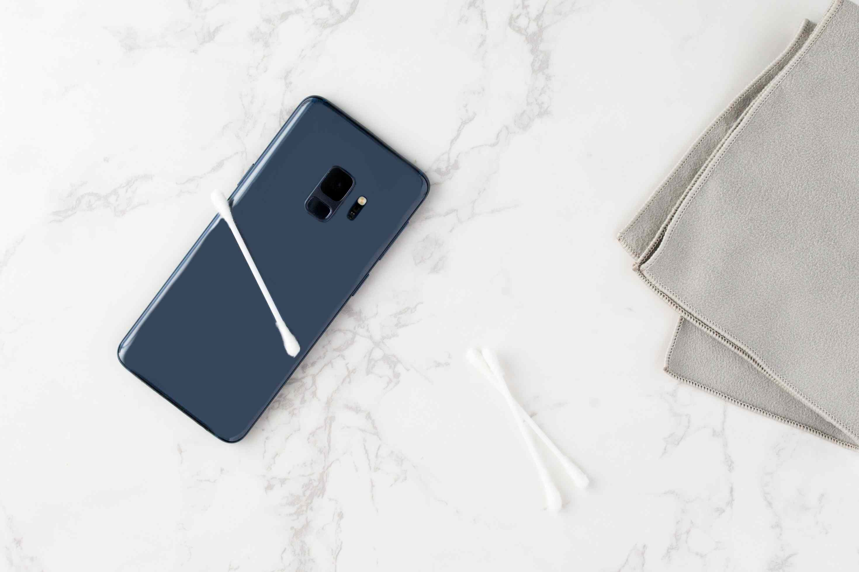 use cotton swabs to clean crevices in your cell phone