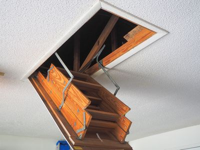 Attic ladder pulled down from ceiling