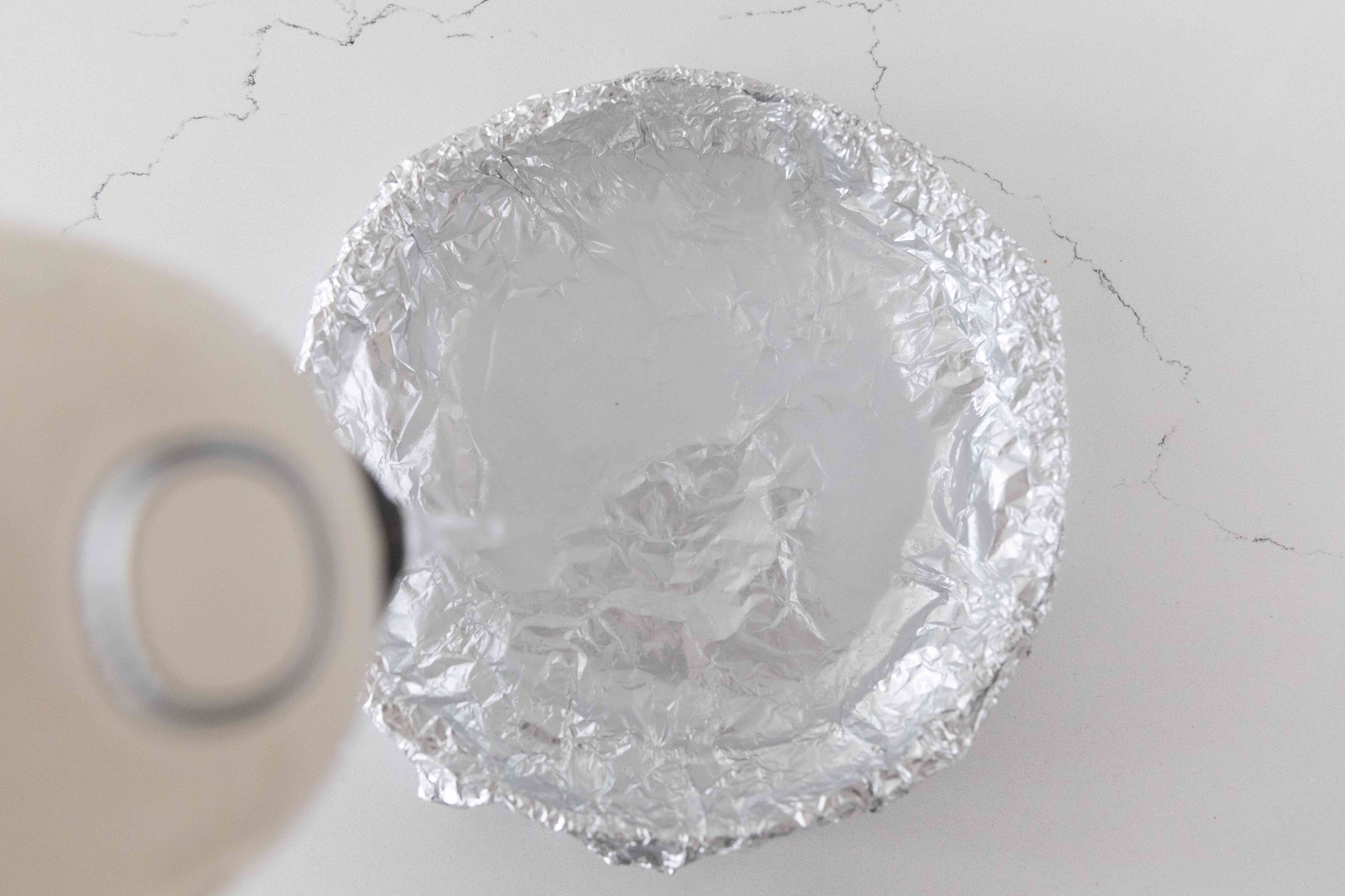 adding boiling water to the foil