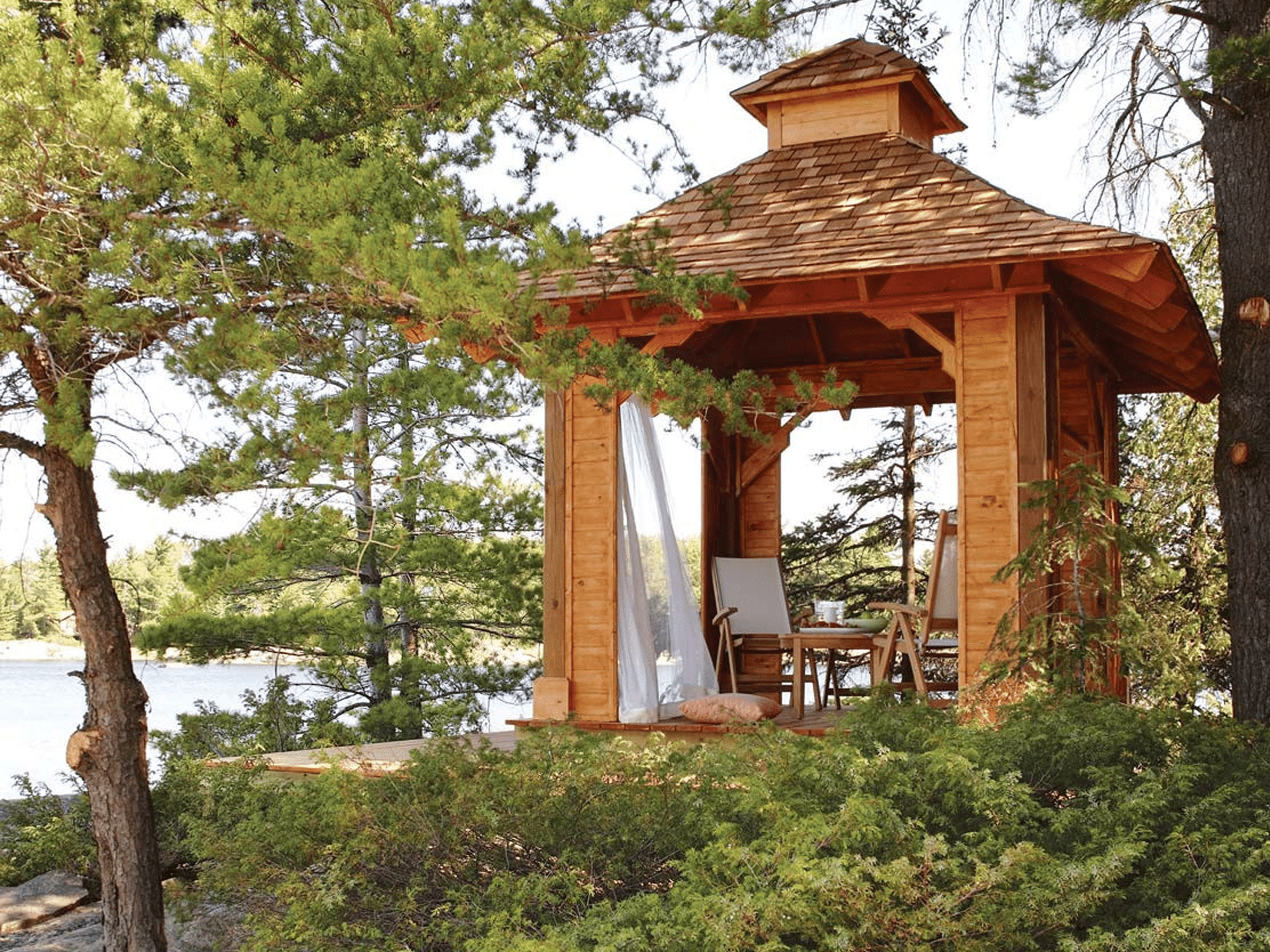 A gazebo by a lake.