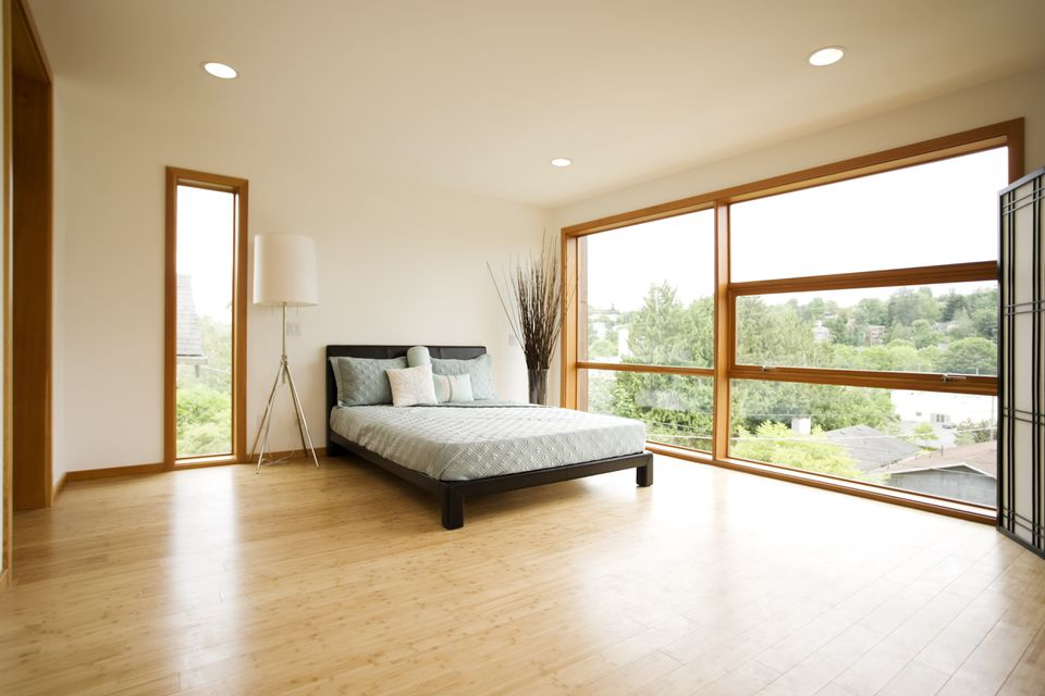 Modern spacious bedroom with bamboo floors