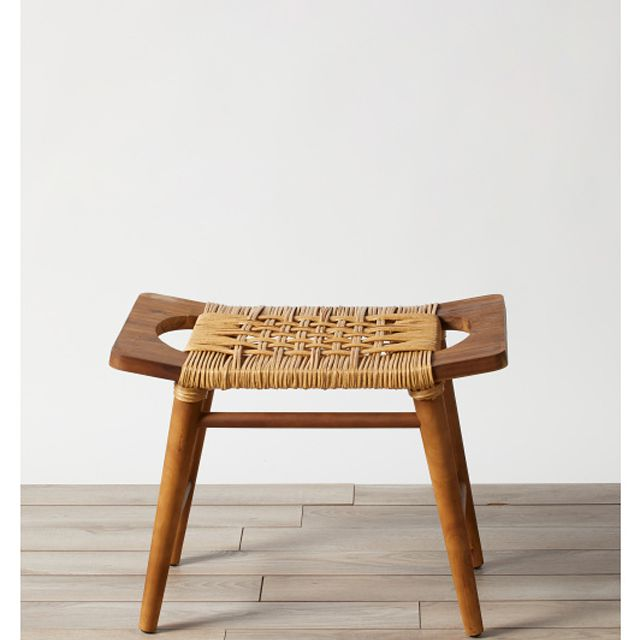 A wicker and wood stool
