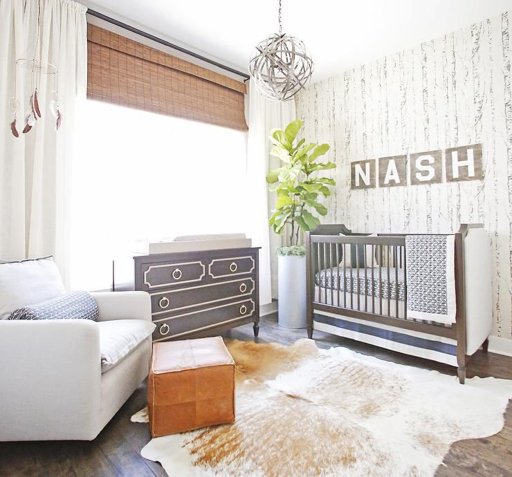 Contemporary nursery with rustic birchwood wallpaper