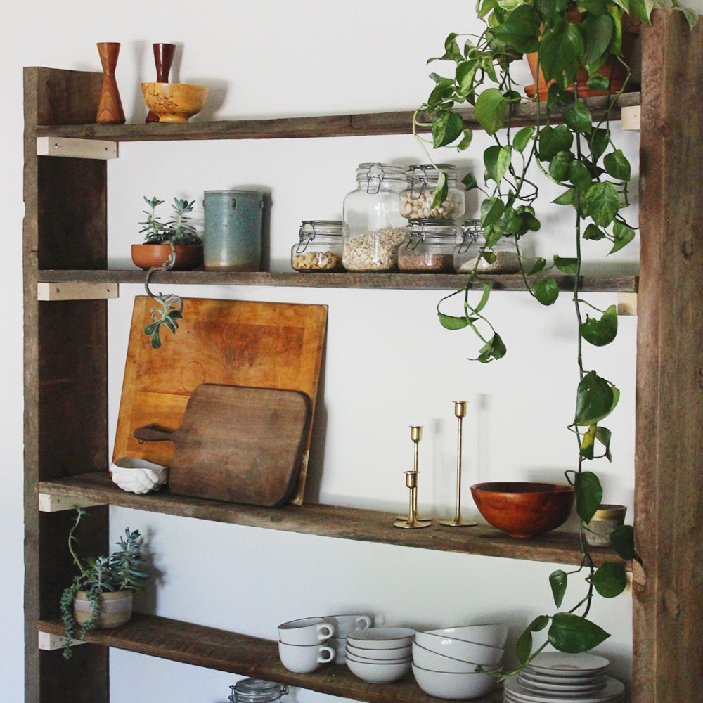 DIY wooden bookshelf with an assortment of objects on the shelves