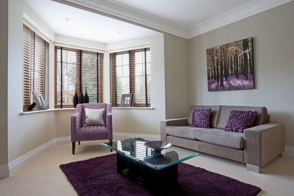 Purple rug over beige broadloom