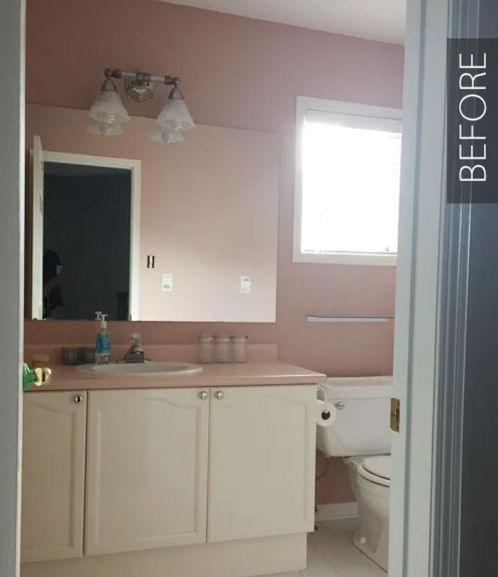 Dated bathroom with pink walls and pink vanity top.