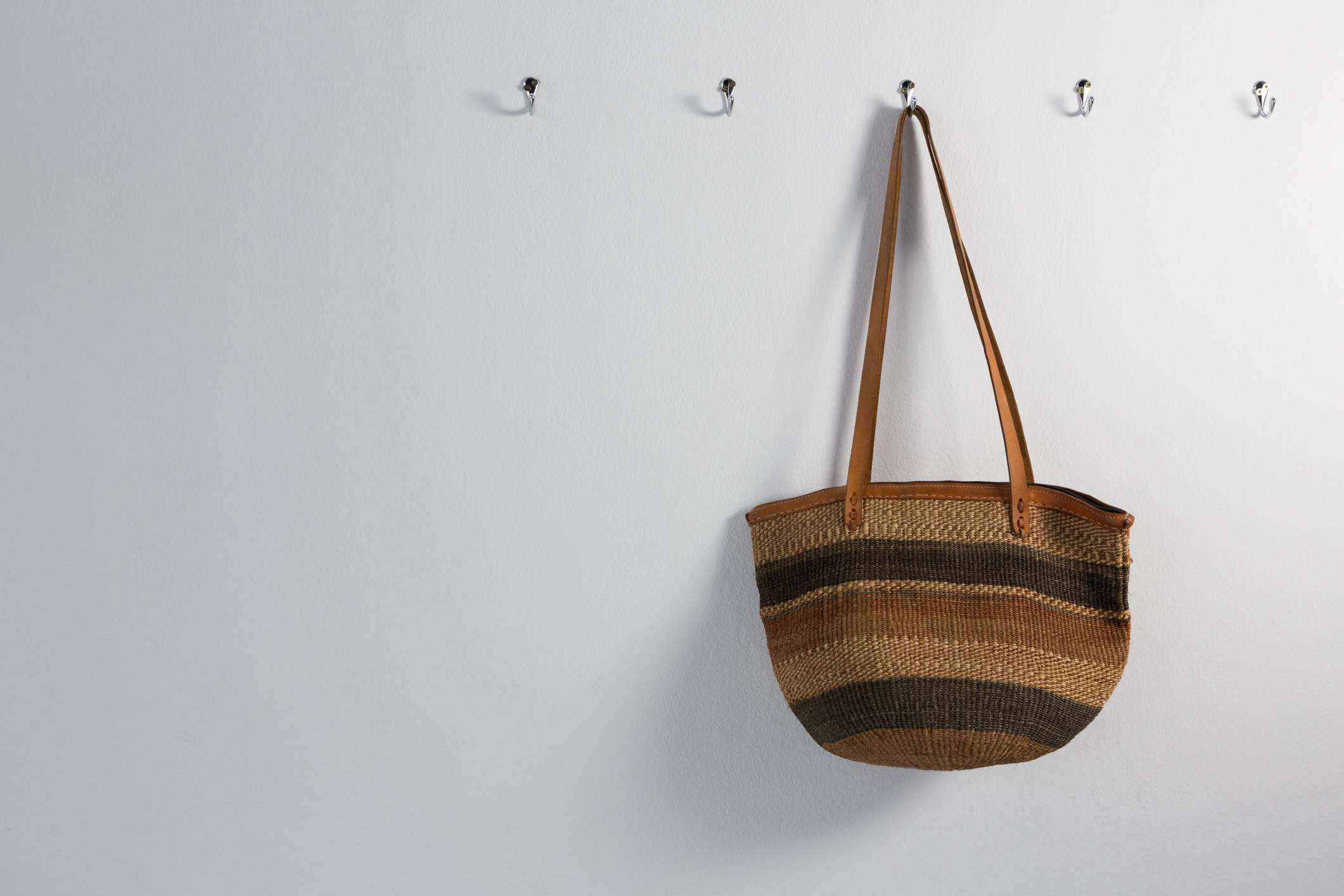 A purse hanging on hooks