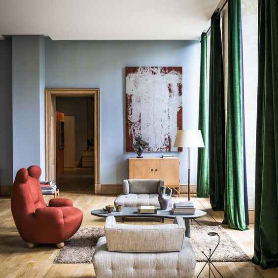 Stylish living room with floor to ceiling drapery to show off the height of the room