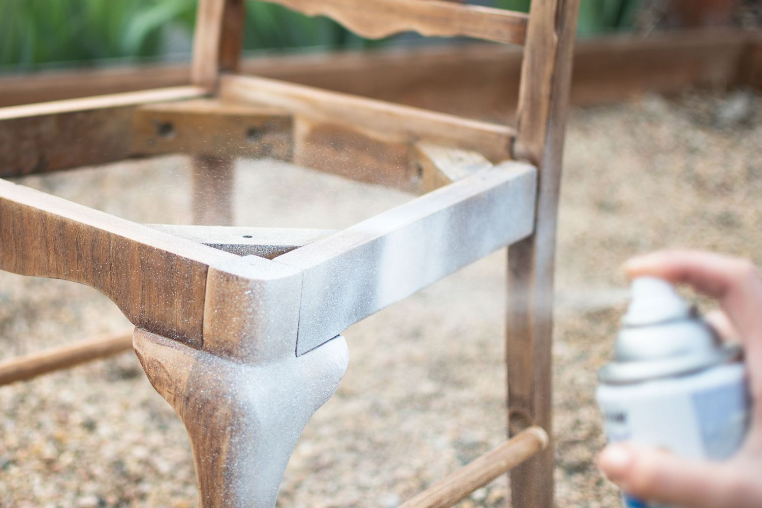 White primer sprayed on wooden chair with spray can