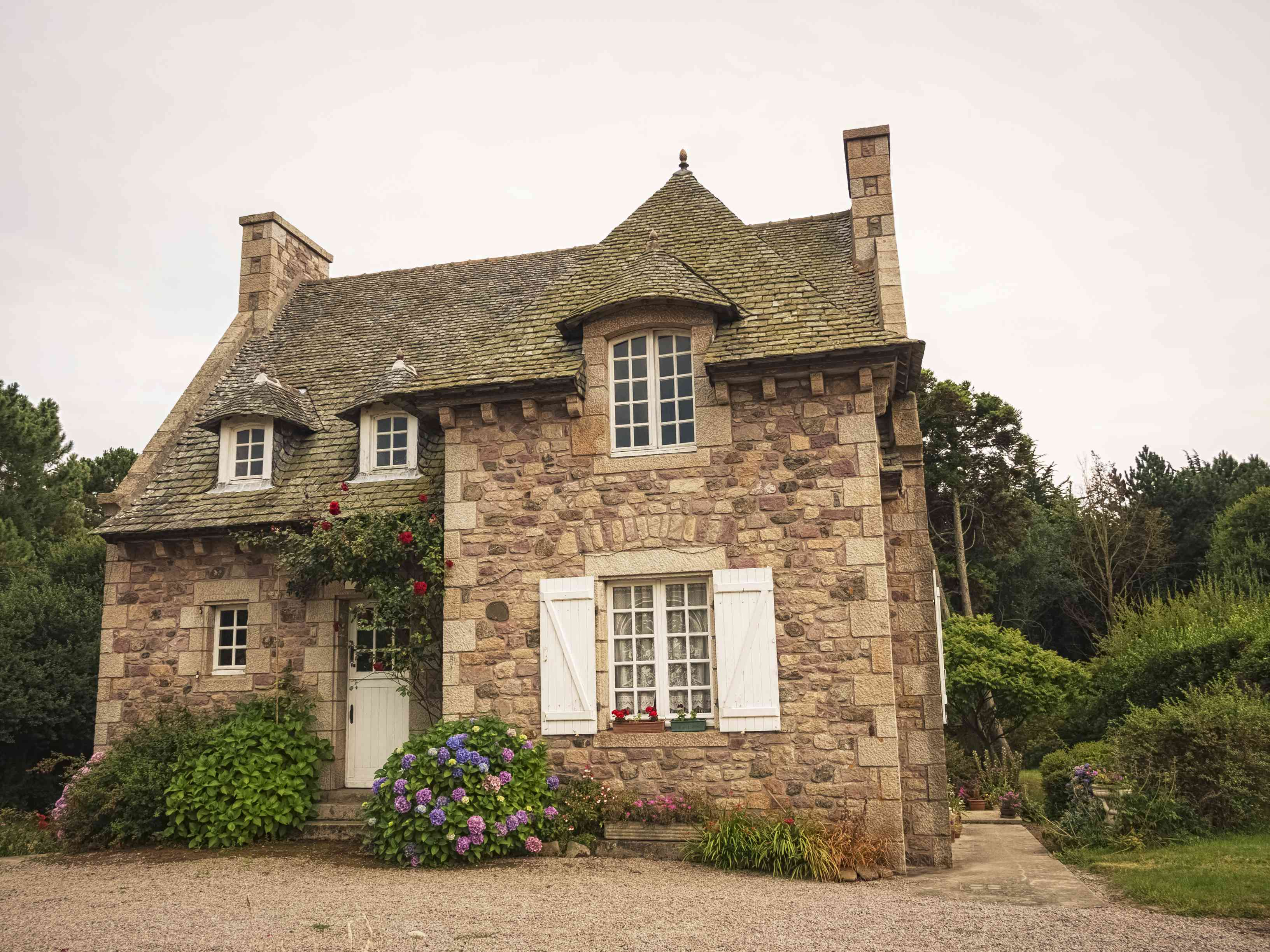A French country home with a stone facade.