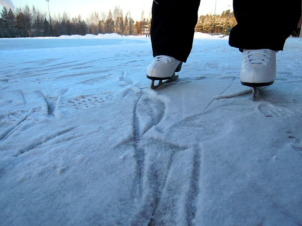 ice skates on lake.