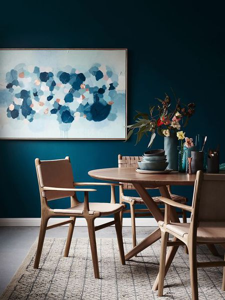 A Rich Blue Color Palette Wooden Furniture And Walls