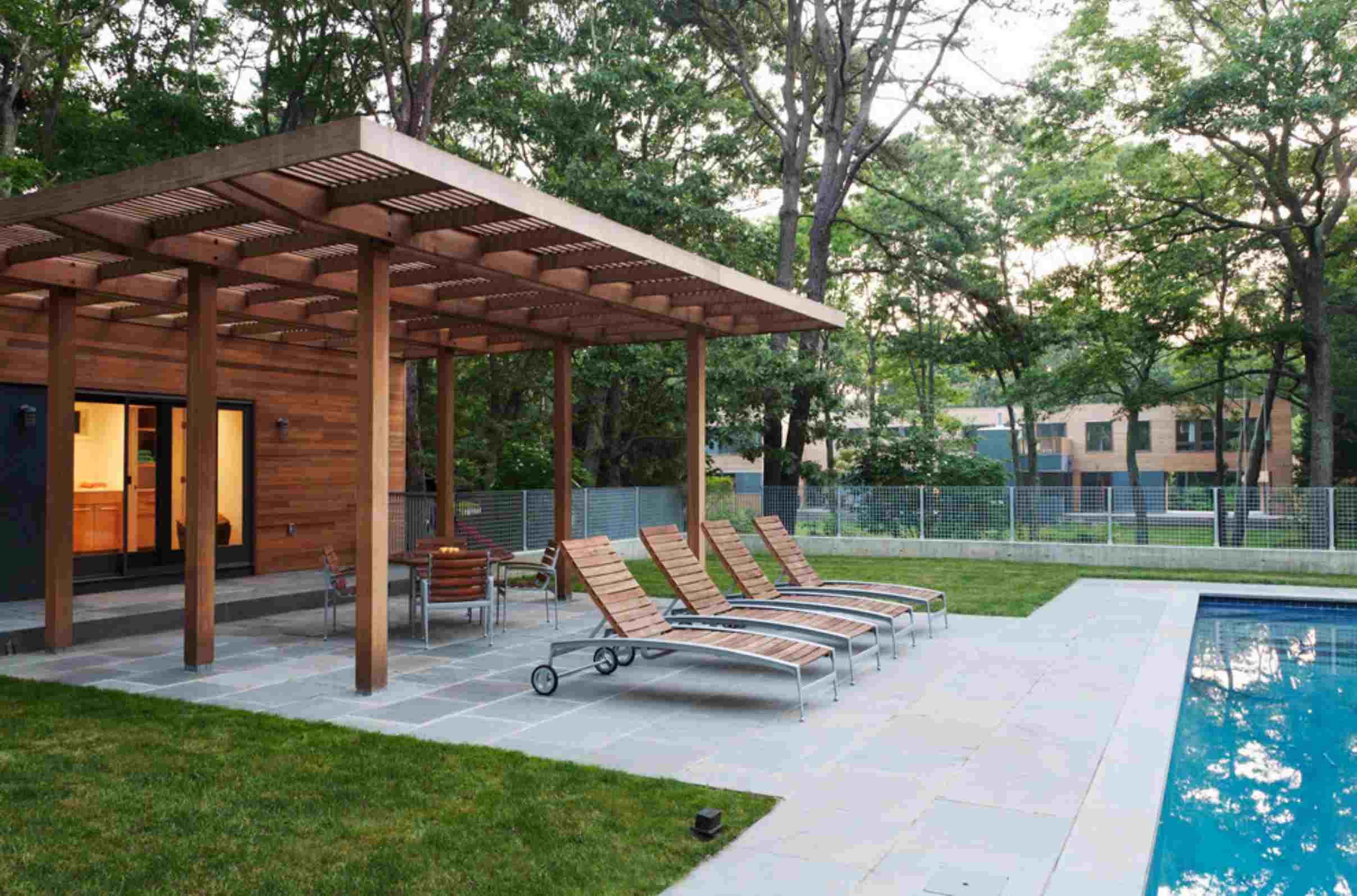 covered patio designs with pool and lounge chairs