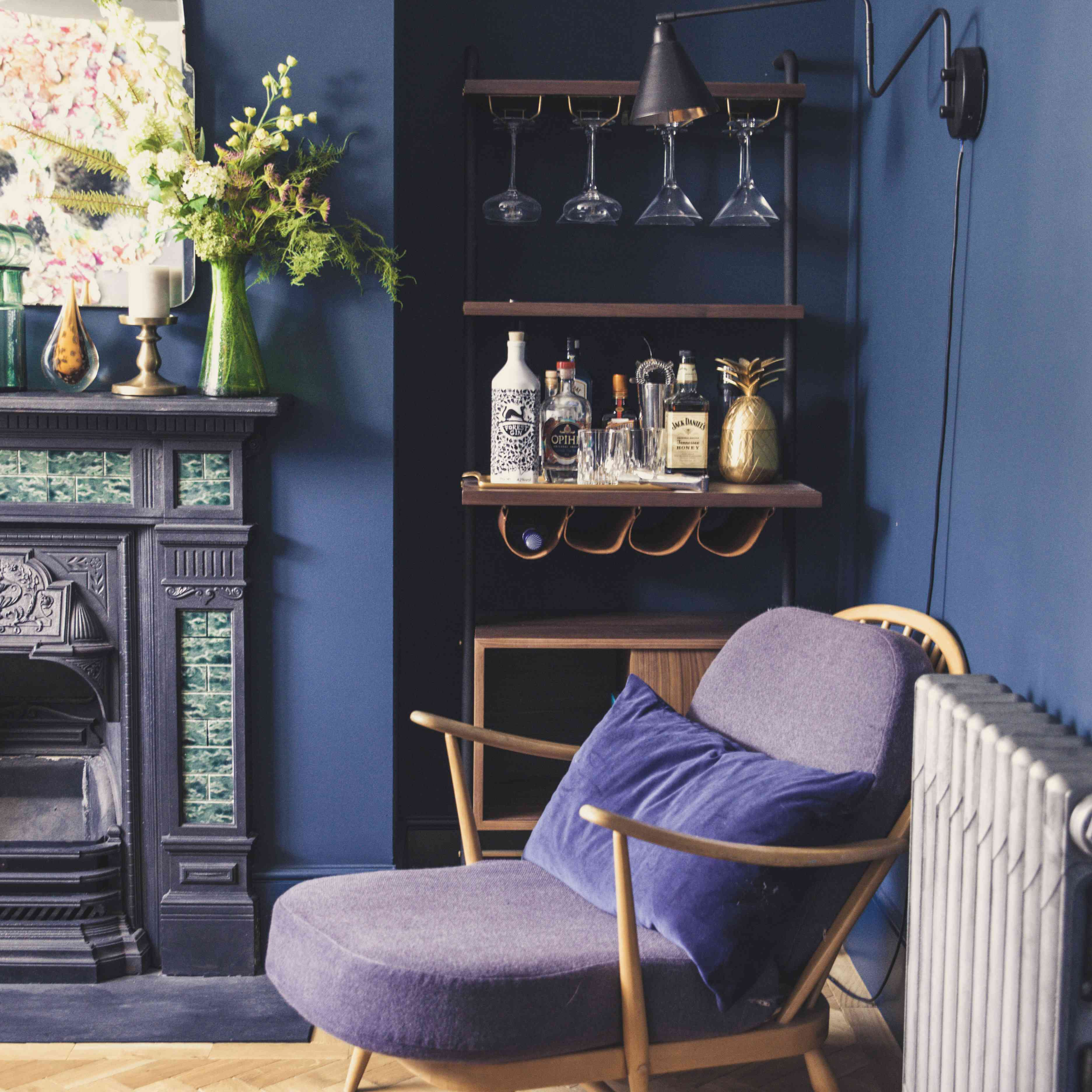 Purple armchair in a navy room.