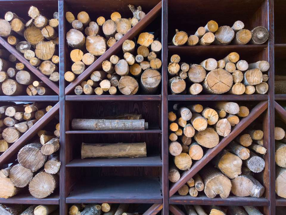 A wooden firewood rack holding firewood